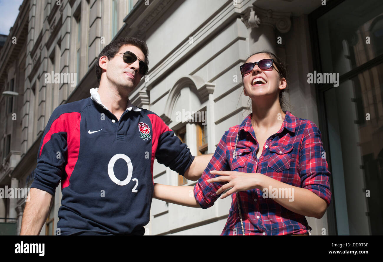 Couple looking up at Walkie Talkie building hot spot - Stock Image