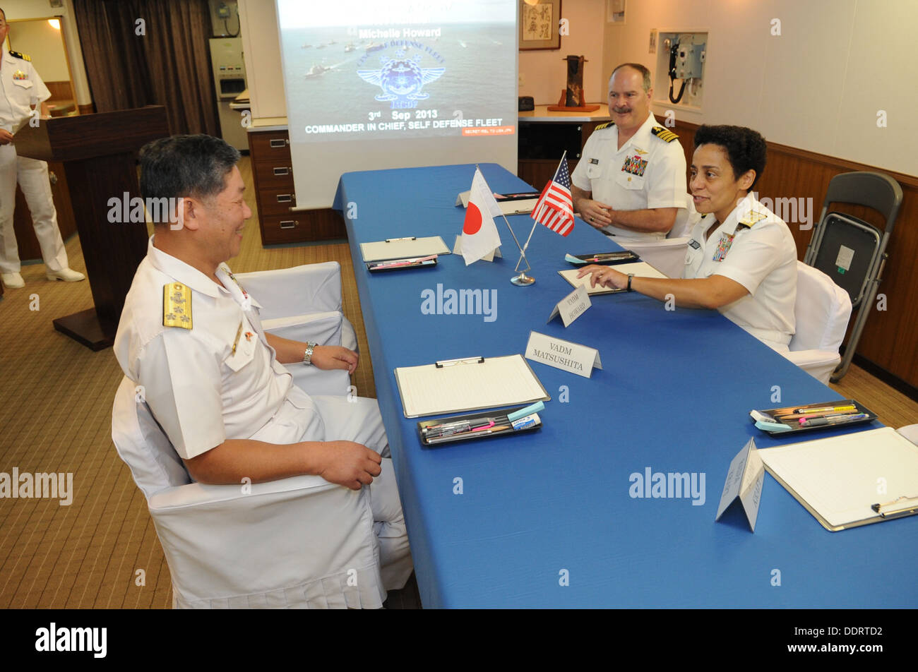 Vice Adm. Michelle Howard, right, Deputy Chief of Naval Operations for operations, plans and strategy, speaks with Japan Mariti - Stock Image