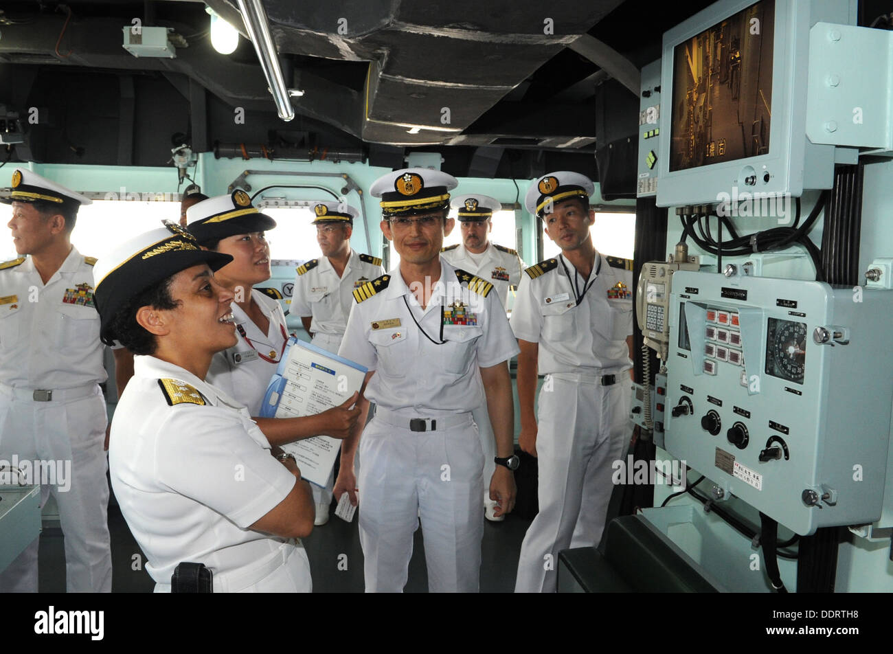Vice Adm. Michelle Howard, Deputy Chief of Naval Operations for Operations, Plans and Strategy, tours the bridge deck of the Ja - Stock Image