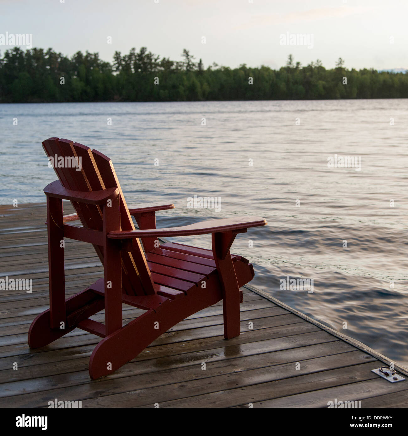 Adirondack chair on a dock at the Lake of The Woods, Ontario ...