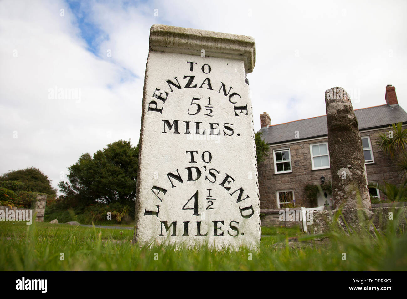 An old stone milestone on the roadside between Penzance and Lands End, Cornwall, England, U.K. - Stock Image