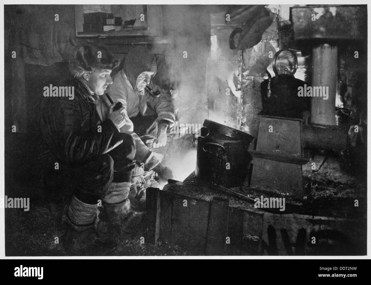 'Oates and Meares at the Blubber Stove in the Stables', Antarctica, 1911. Artist: Herbert Ponting - Stock Image