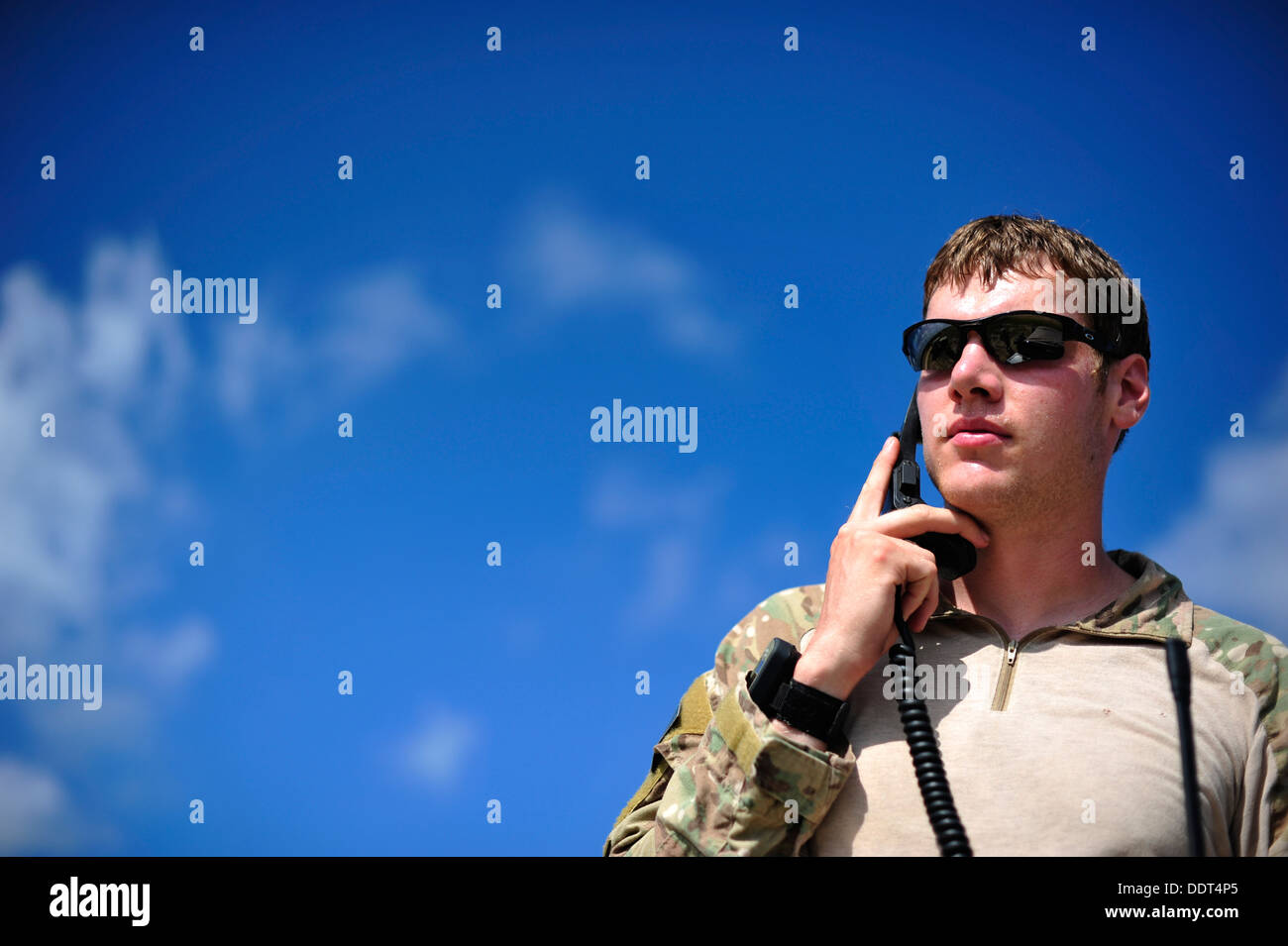 U.S. Air Force combat controller from the 21st Special Tactics Squadron, Fort Bragg, N.C. conducts air traffic control operatio - Stock Image