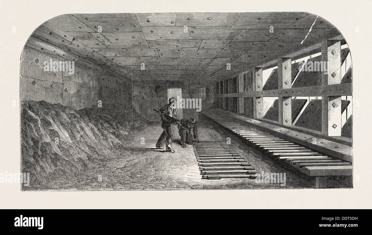 THE MANUFACTURE OF GUN BARRELS, AT BIRMINGHAM, UK: THE PROOF HOUSE, 1851 engraving - Stock Image