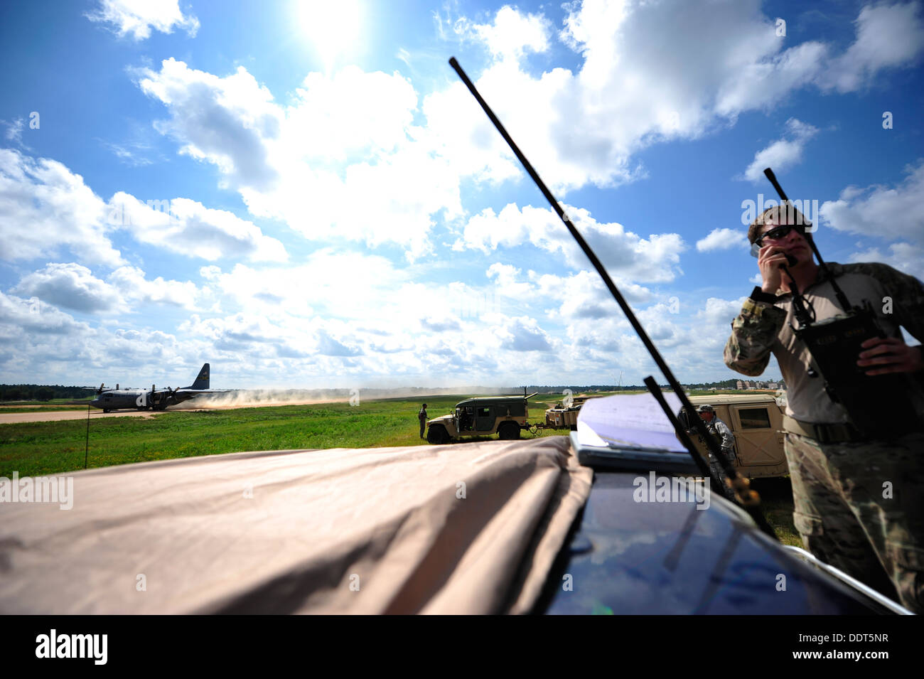 U.S. Air Force combat controller from the 21st Special Tactics Squadron, Fort Bragg, N.C. conducts air traffic control operation - Stock Image