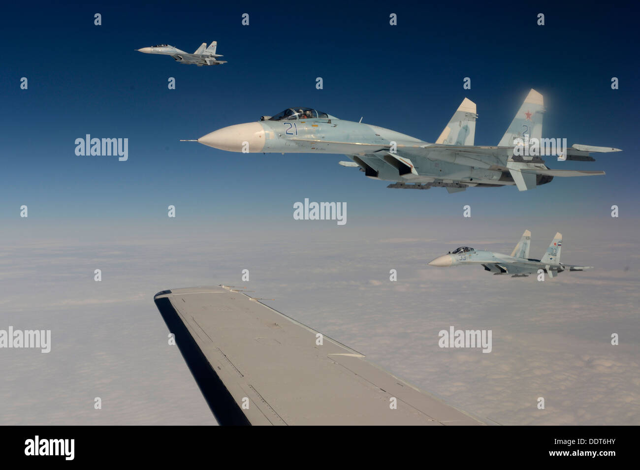 Russian Federation Air Force Su-27 Sukhois intercepts a simulated hijacked aircraft entering Russian airspace Aug. Stock Photo