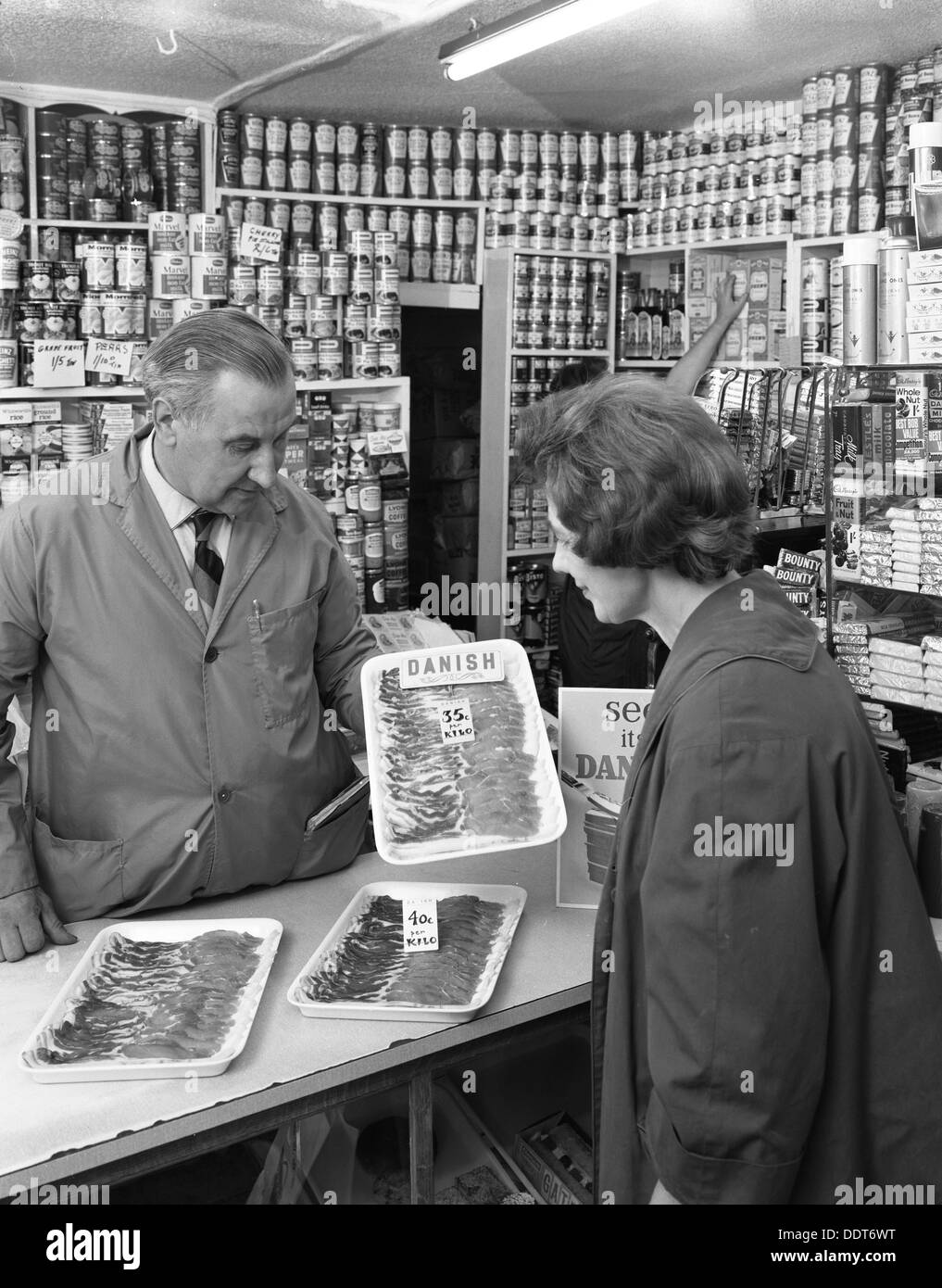 New metric system of selling bacon, Stocksbridge, Sheffield, South Yorkshire, 1966. Artist: Michael Walters - Stock Image
