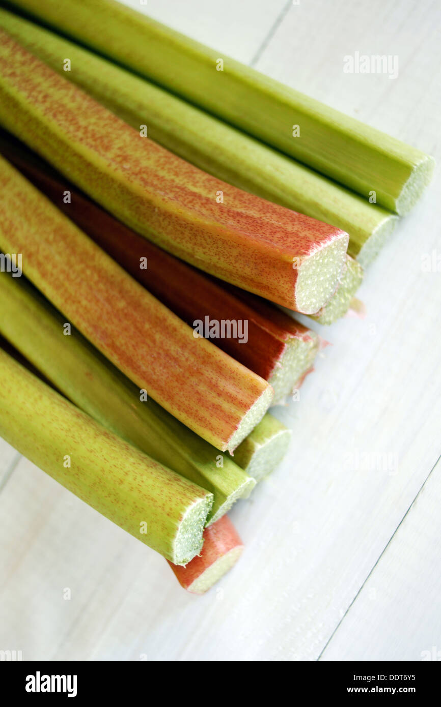 Freshly cut Rhubarb stems shot with shallow depth of field - Stock Image