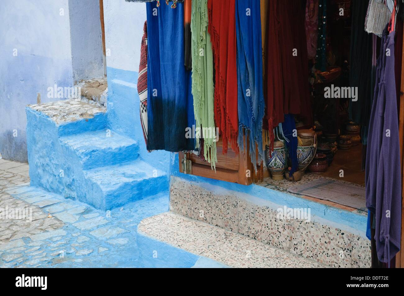 Scarves and other handcraft regional products on exhibit in a tourist shop in Chaouen, Morocco - Stock Image