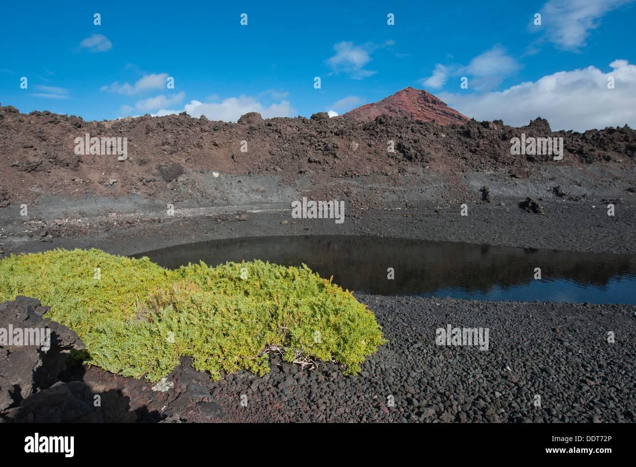 Coastal saltwater lagoon in black sand beach near Los Hervideros, Lanzarote, Canary Islands, Spain. - Stock Image