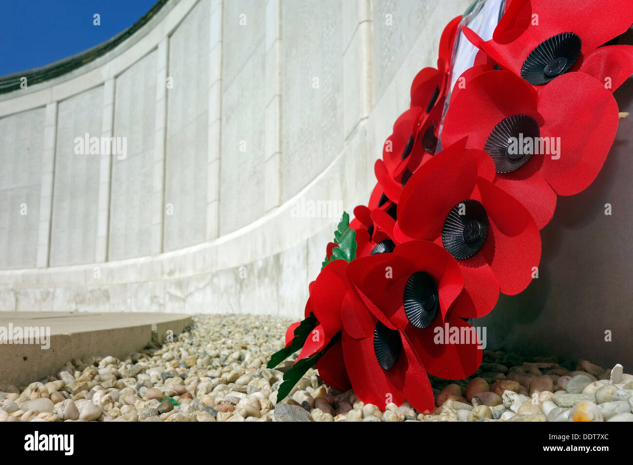 Poppies at WW1 Tyne Cot Memorial to the Missing, Commonwealth War Graves Commission cemetery for World War One British Stock Photo
