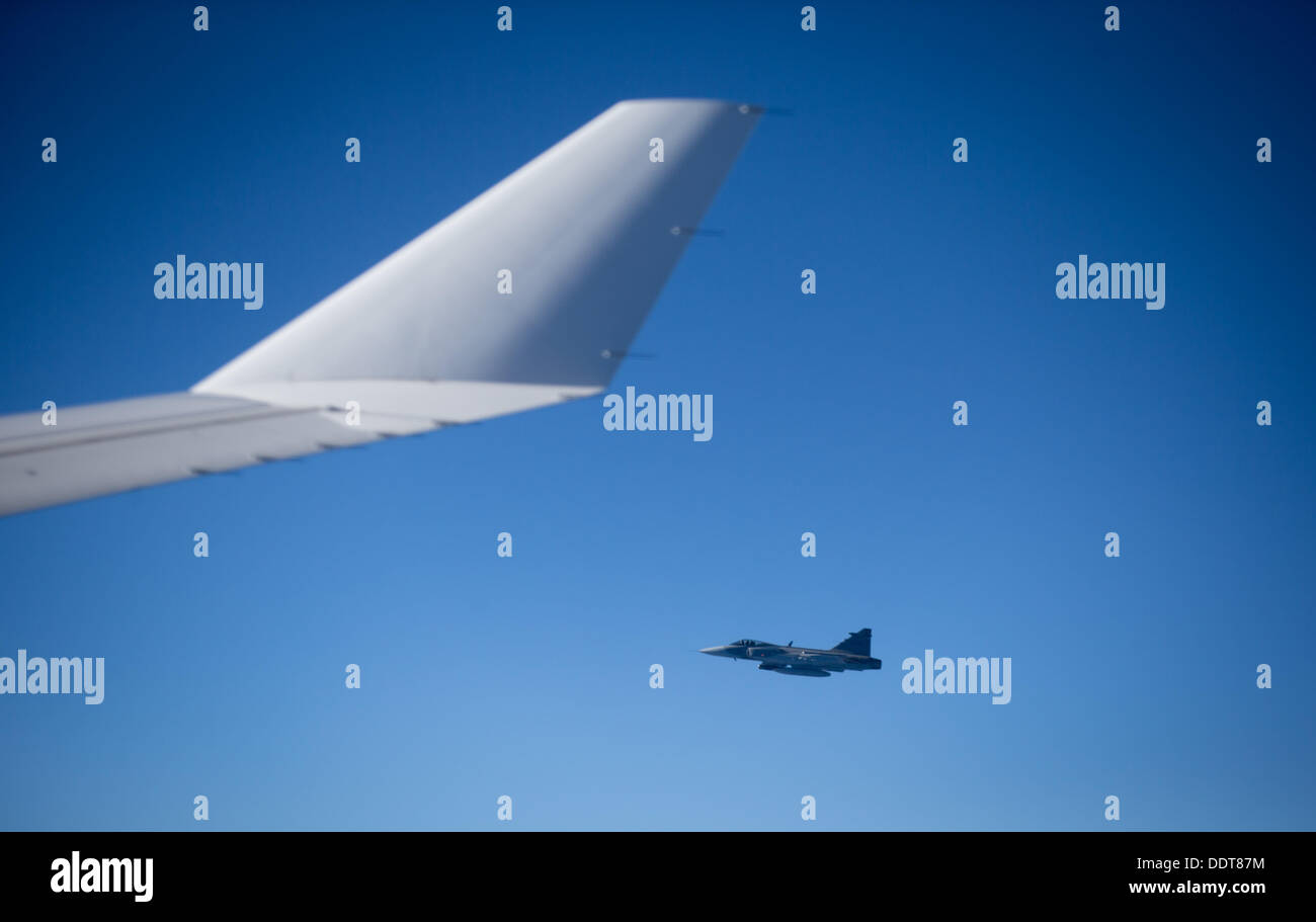 A Swedish fighter jet accompanies German ChancellorMerkel's Airbus A340 on the flight back to Berlin from St. Petersburg,Germany, Stock Photo