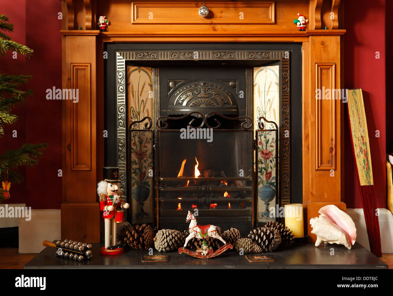 christmas fireplace with rocking horse pine cones nutcracker sleigh bells and christmas decorations