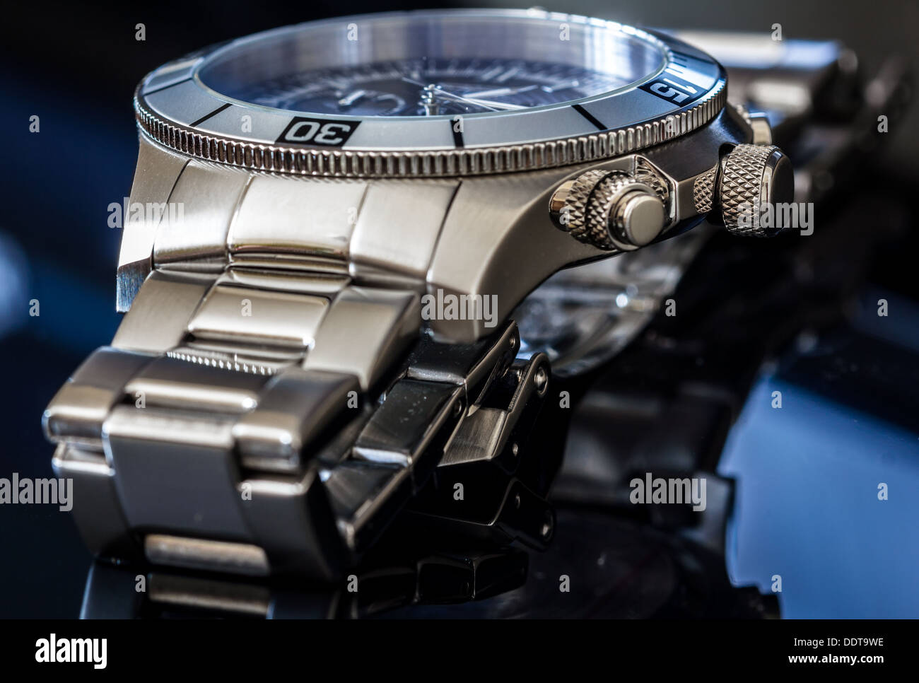 Luxury Watch over reflective surface. Selective focus, shallow depth of field. - Stock Image