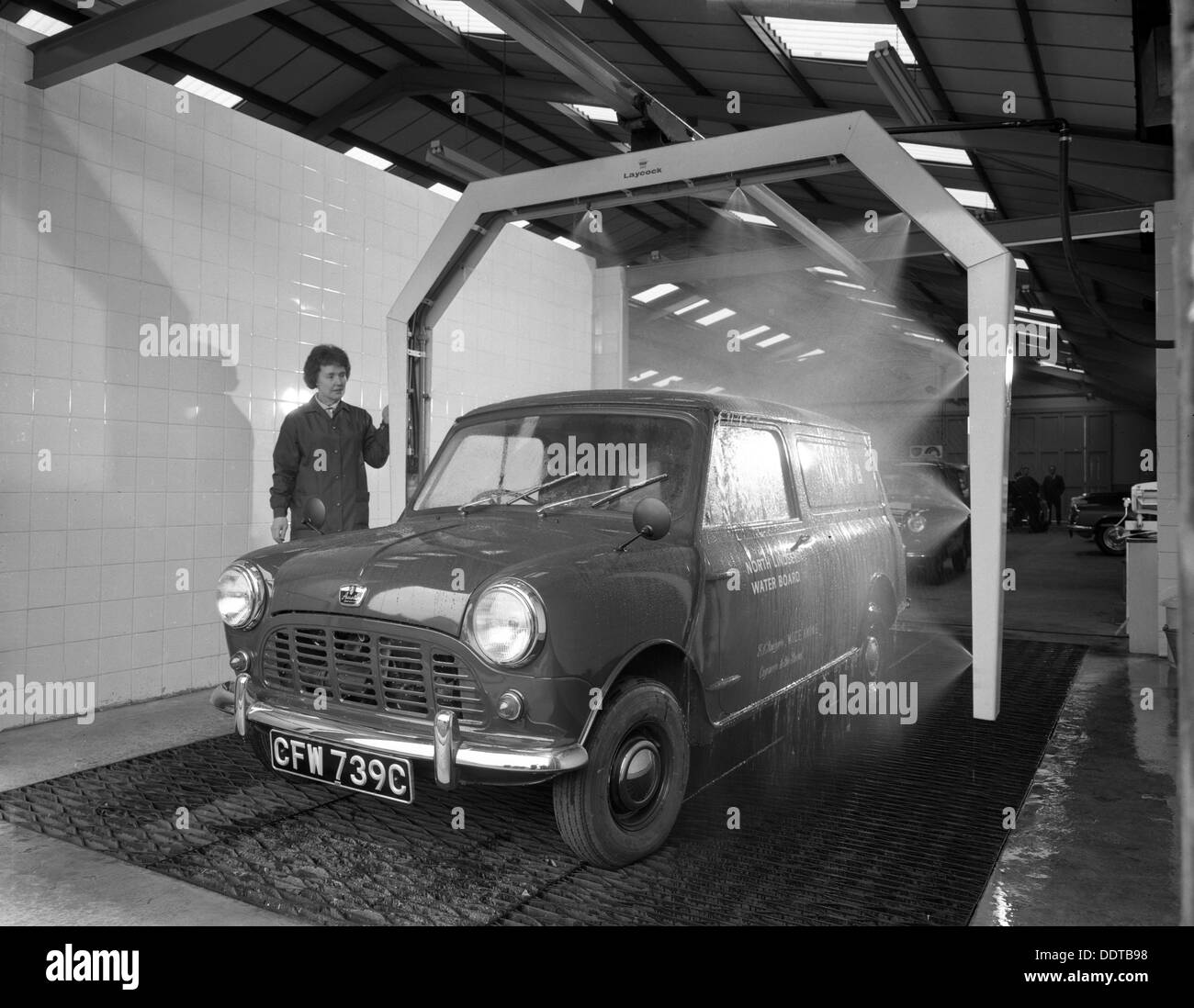 Mini van being washed in a car wash, Co-op garage, Scunthorpe, Lincolnshire, 1965.  Artist: Michael Walters Stock Photo