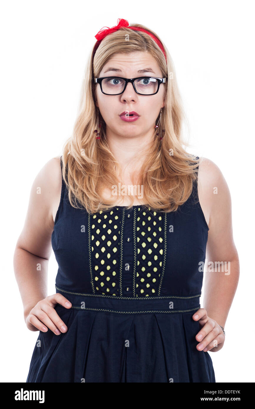 Surprised woman wearing dress and eyeglasses, isolated on white background. - Stock Image