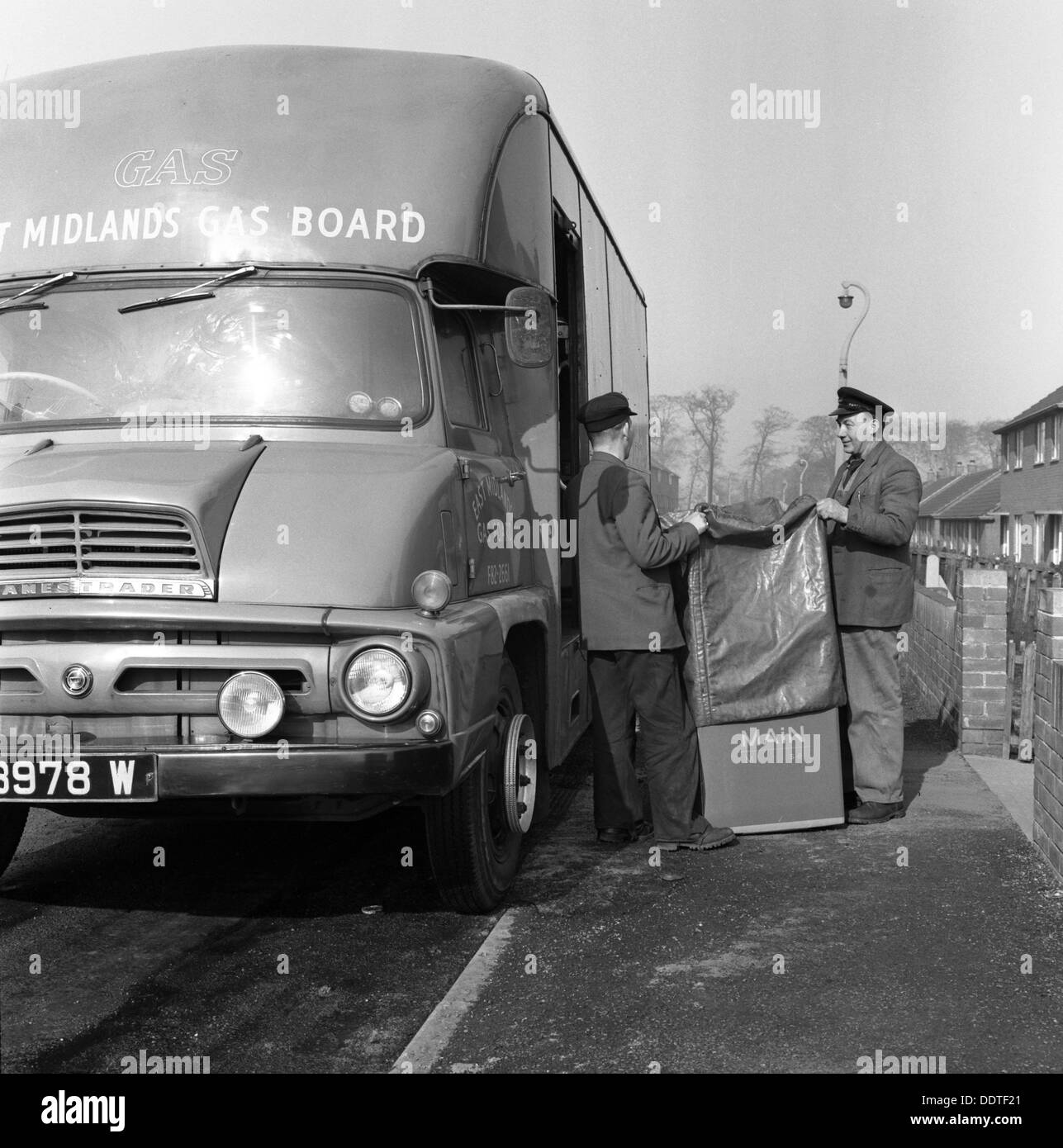 Home delivery of a cooker, Darfield, Barnsley, South Yorkshire, 1963. Artist: Michael Walters - Stock Image