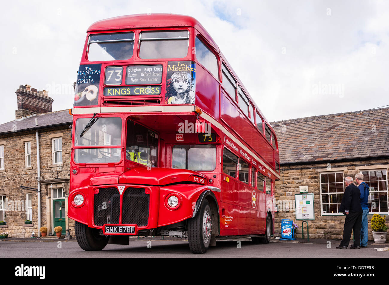 An old red double decker London bus at Leyburn Station on the Wensleydale Railway in Leyburn , North Yorkshire, England, Uk - Stock Image