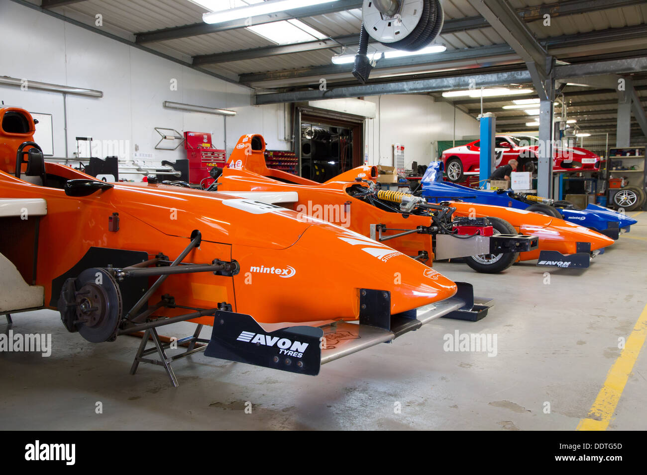 Formula Silverstone single seater racing cars in the garage, used for driving experiences at Silverstone Racing Circuit. - Stock Image