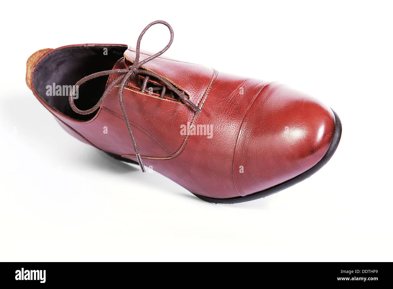 Stylish man's shoes with laces from skin and suede on a white background. Shades of the brown - Stock Image