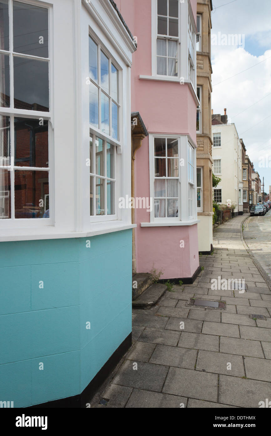 Colourful blue and pink painted Georgian and Regency houses with bay windows in Kingsdown, Bristol. - Stock Image