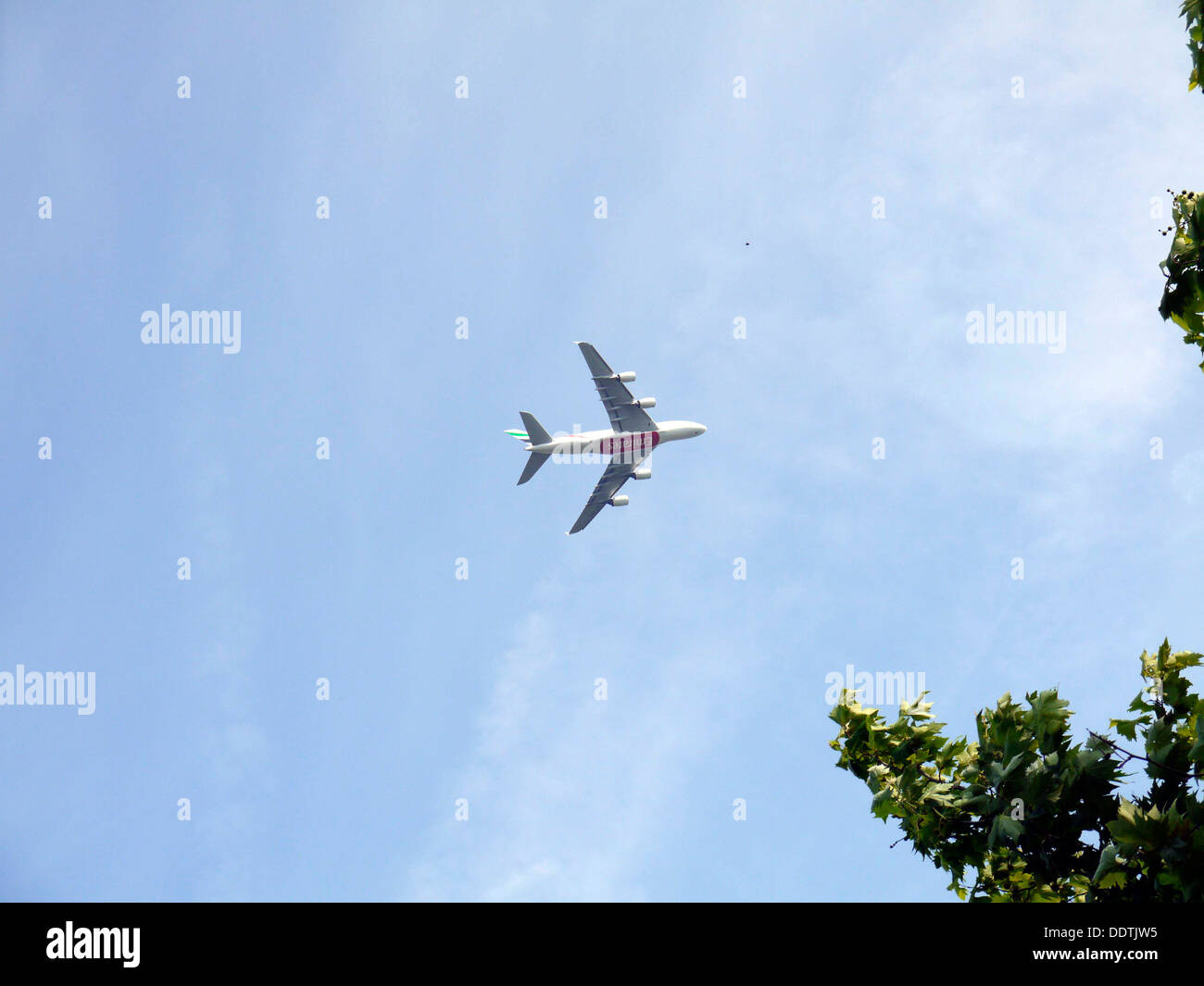 An Emerites Airoplane in the air - Stock Image