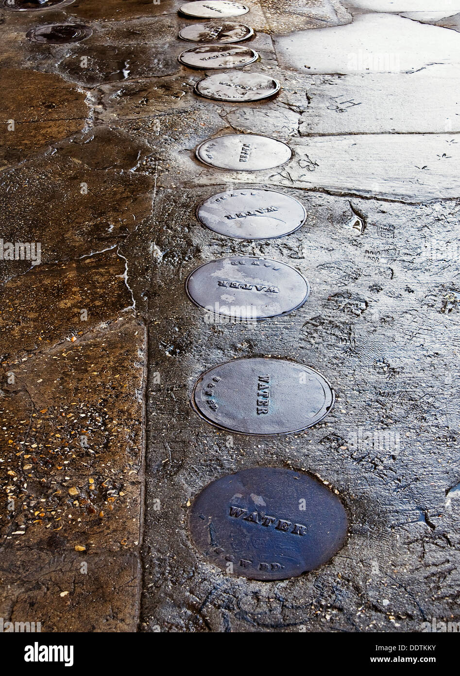 water meter manhole covers in New Orleans, Louisianna - Stock Image