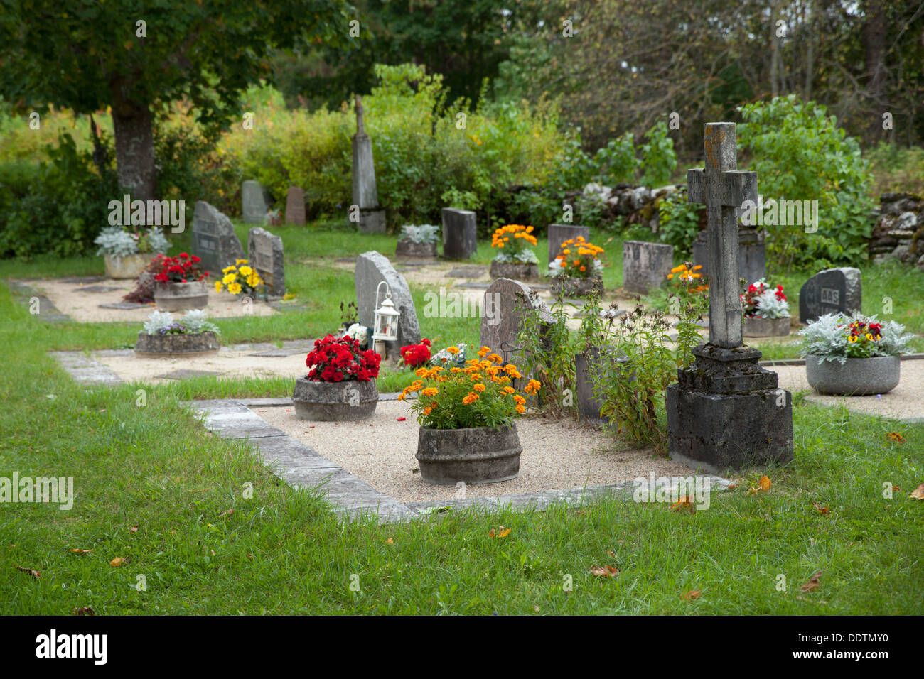 Cemetery with several memorials and flowers - Stock Image