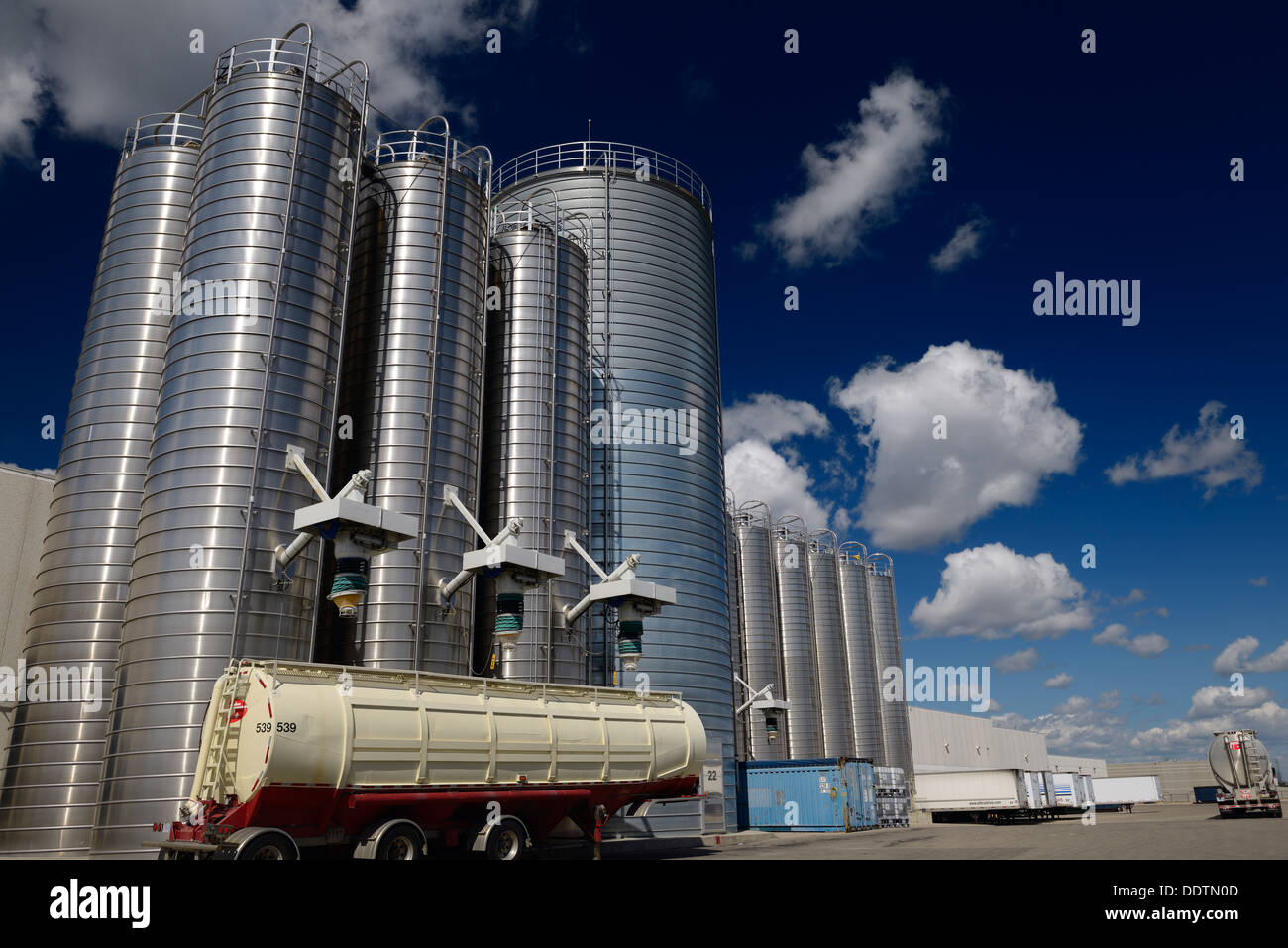 Large stainless steel tanks and trucks containing plastic ingredients for extrusion industry Vaughan Canada - Stock Image