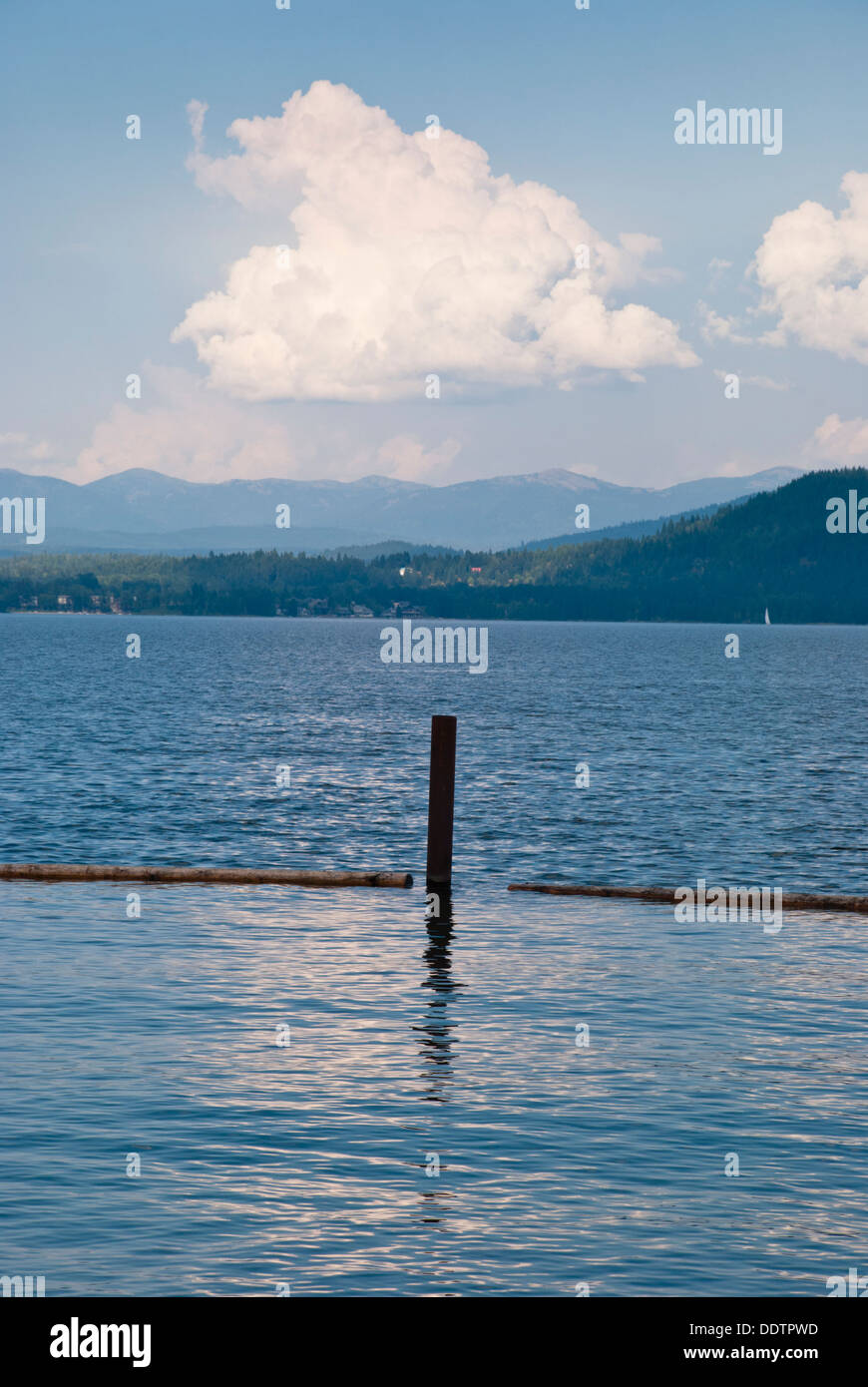 An early evening cloud hovers over Lake Pend Oreille, Sandpoint, Idaho, USA. - Stock Image