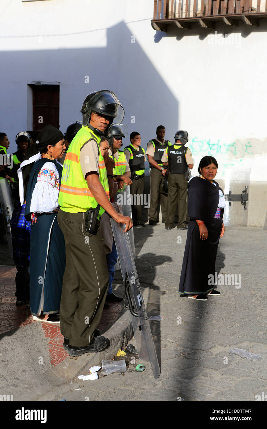 Riot police with combat shields on standby at Inti Raymi festival in Cotacachi, Ecuador - Stock Image