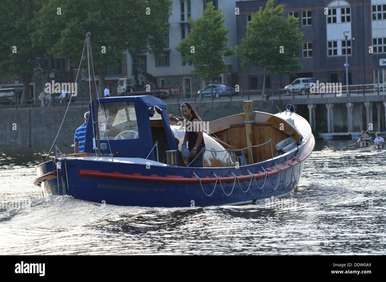 River Avon, people in a motor boat on the river - Stock Image