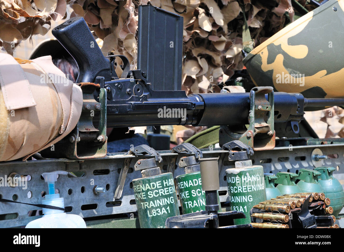 War and Peace Revival, July 2013. Folkestone Racecourse, Kent, England, UK. 7.62MM Rifle, hand grenades, camouflage - Stock Image