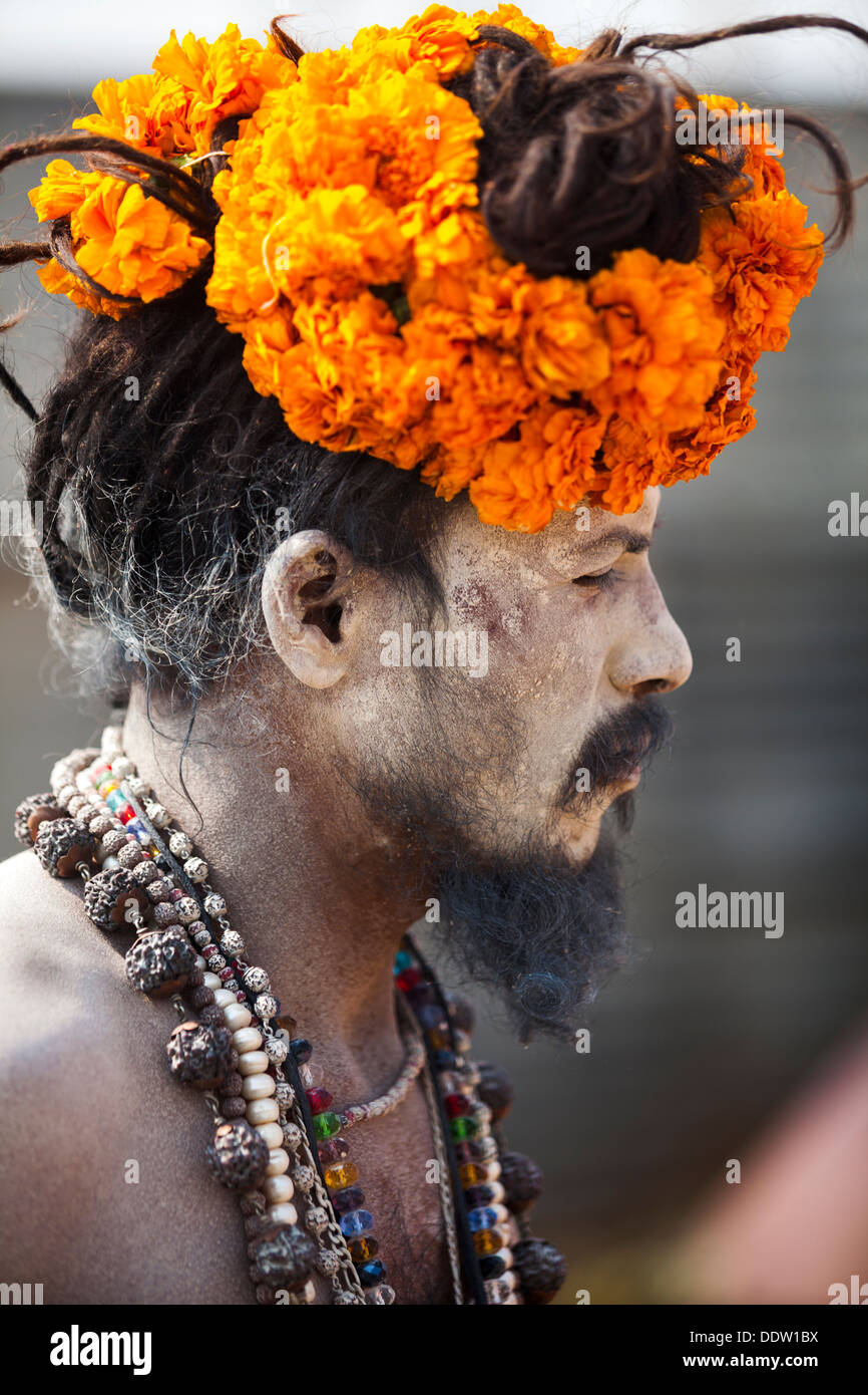 Naga Sadhu Portrait - The Great Renounce covered with beads, wooden ash and tilak on his forehead at Kumbh Mela 2013, India - Stock Image