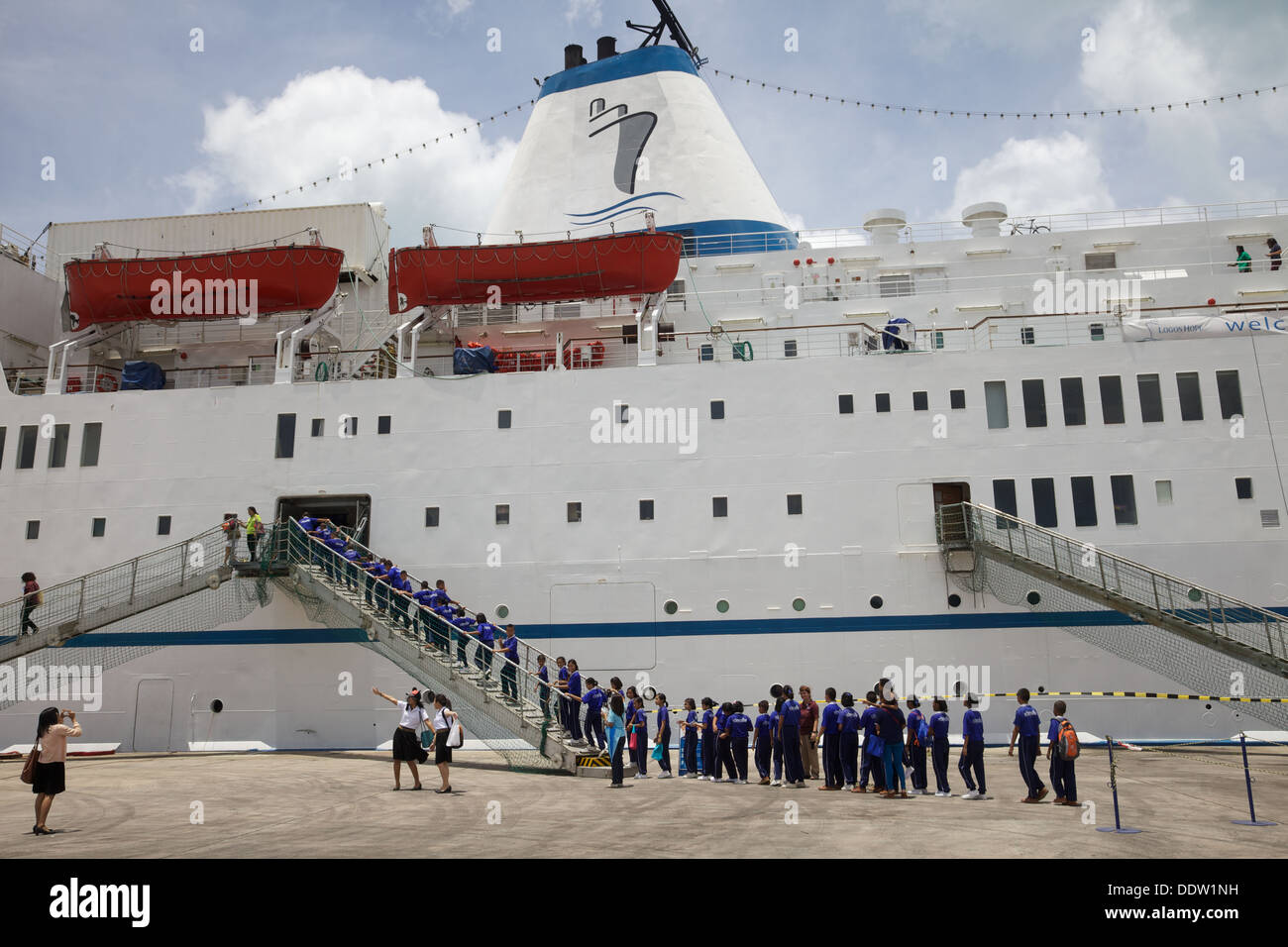 School children going abroad the Logos Hope, mobile book fair, tied up in Phuket harbour, Thailand - Stock Image