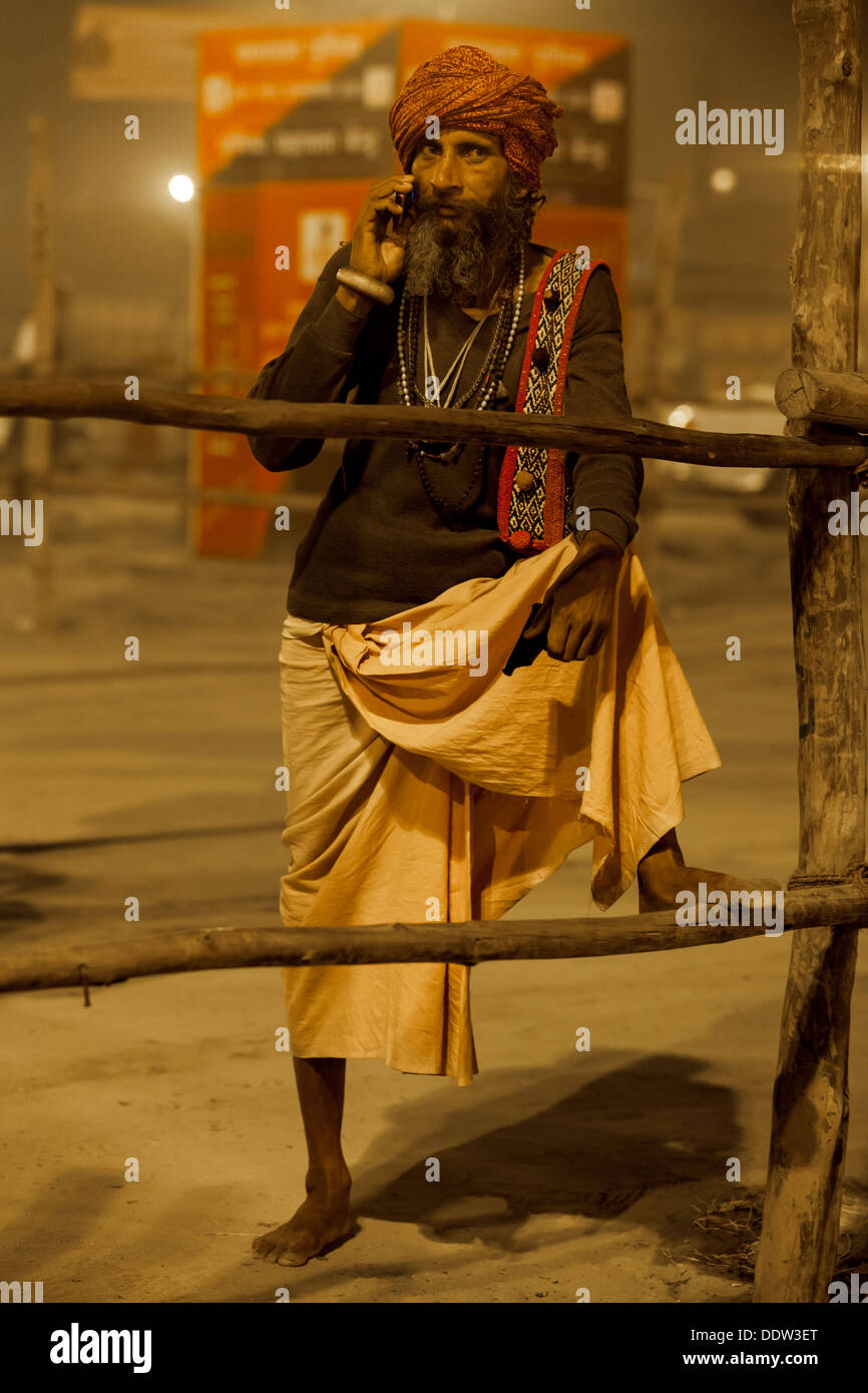 Naga Sadhu - The Great Renounce with technology they all connected on the phone at Kumbh Mela 2013, India - Stock Image