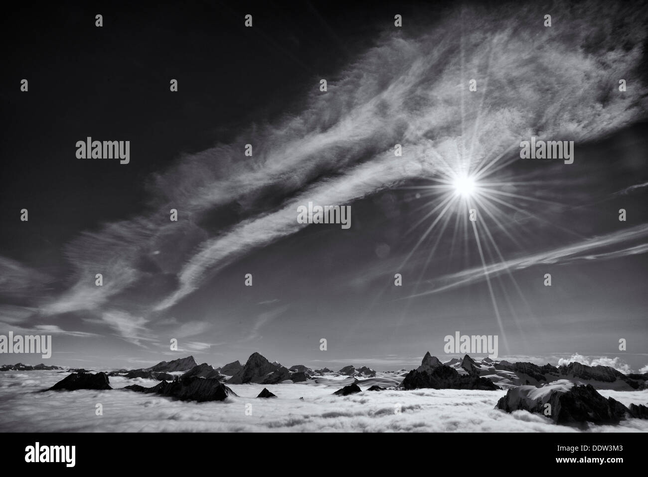 A sea of cloud below the Pigne d'Arolla Stock Photo
