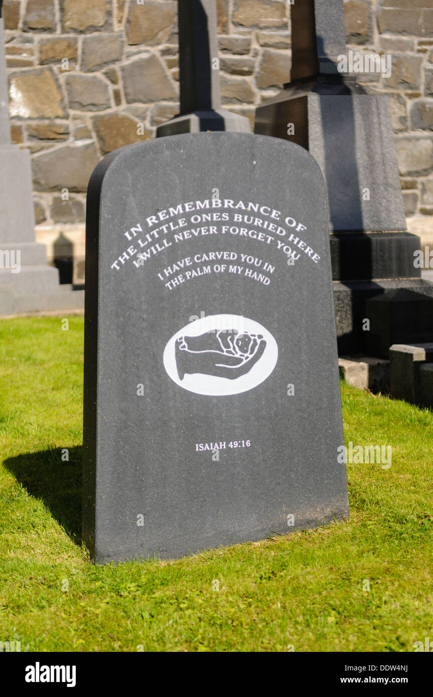 Gravestone in a church graveyard 'In remembrance of the little ones buried here. I will never forget you' - Stock Image