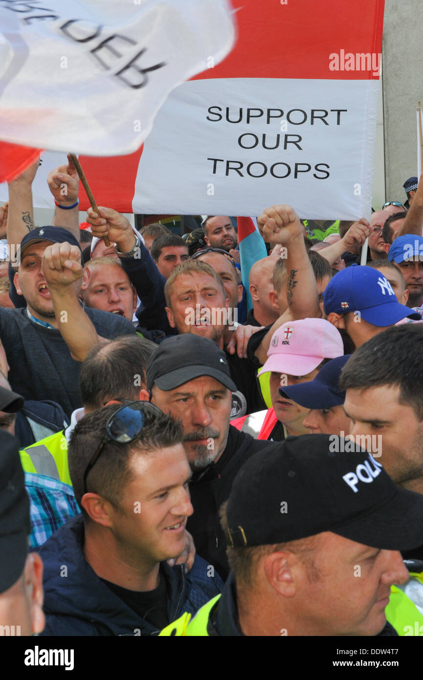 Tower Bridge, London, UK. 7th September2013. Members of the EDL including leader Tommy Robinson (foreground) prepare for their march. Credit:  Matthew Chattle/Alamy Live News - Stock Image