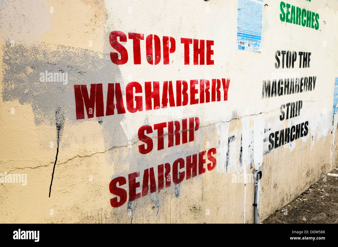 Stenciled graffiti on a wall saying 'Stop the Maghaberry strip searches' - Stock Image