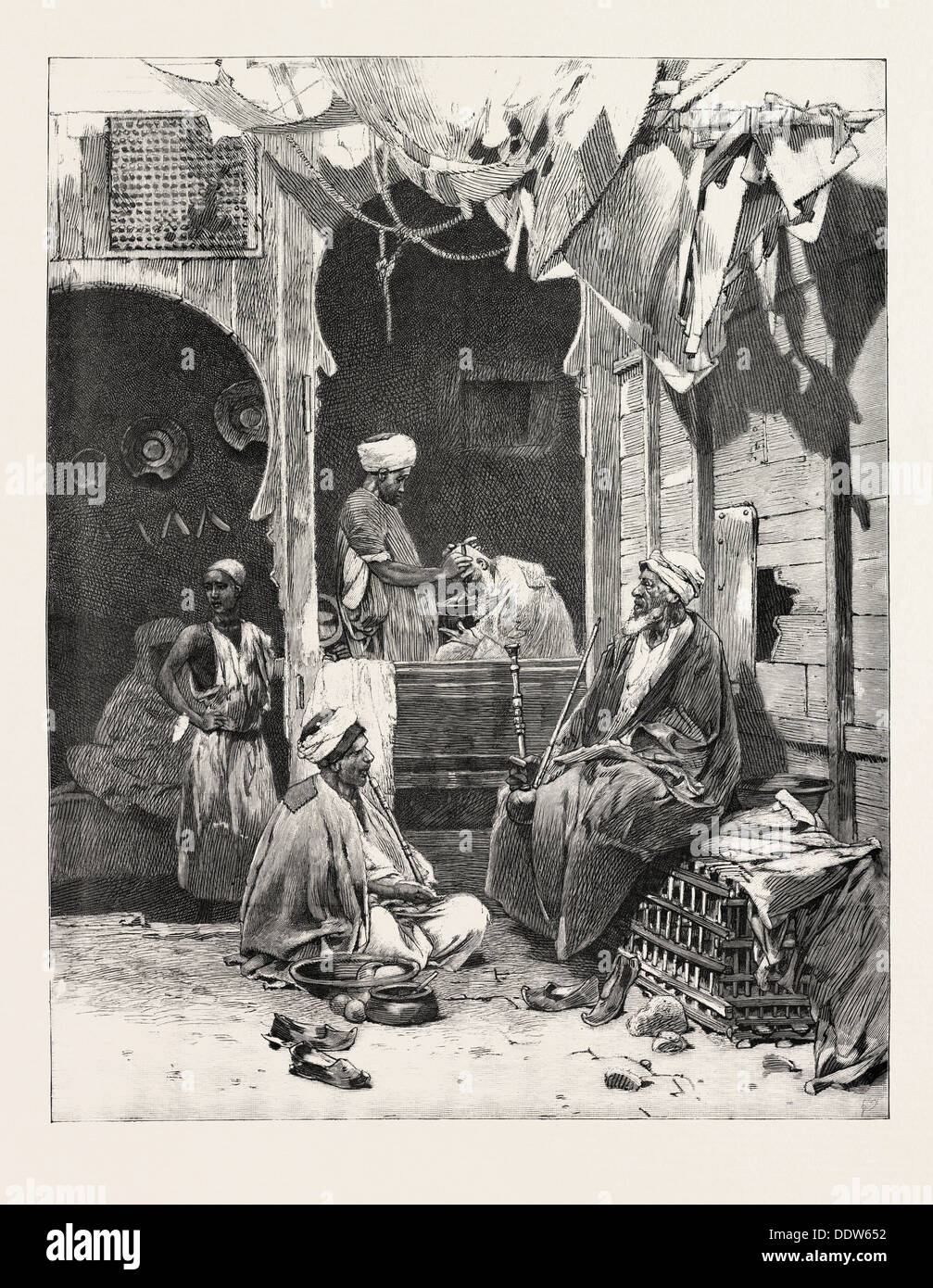 A BARBER'S SHOP AT CAIRO: DISCUSSING THE SITUATION, EGYPT, 1893 engraving - Stock Image