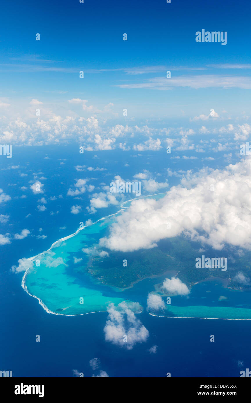 View of Raiatea from the air with clouds. French Polynesia Stock Photo