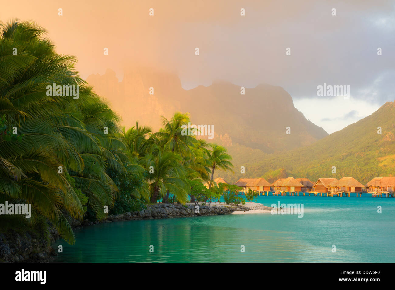 Sunrise and bungalows with lagoon. Bora Bora. French Polynesia. - Stock Image