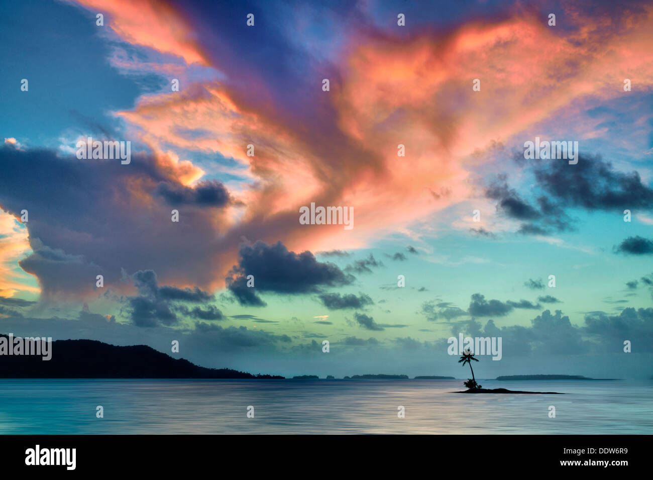Small island and sunset in Bora Bora. French Polynesia. Stock Photo
