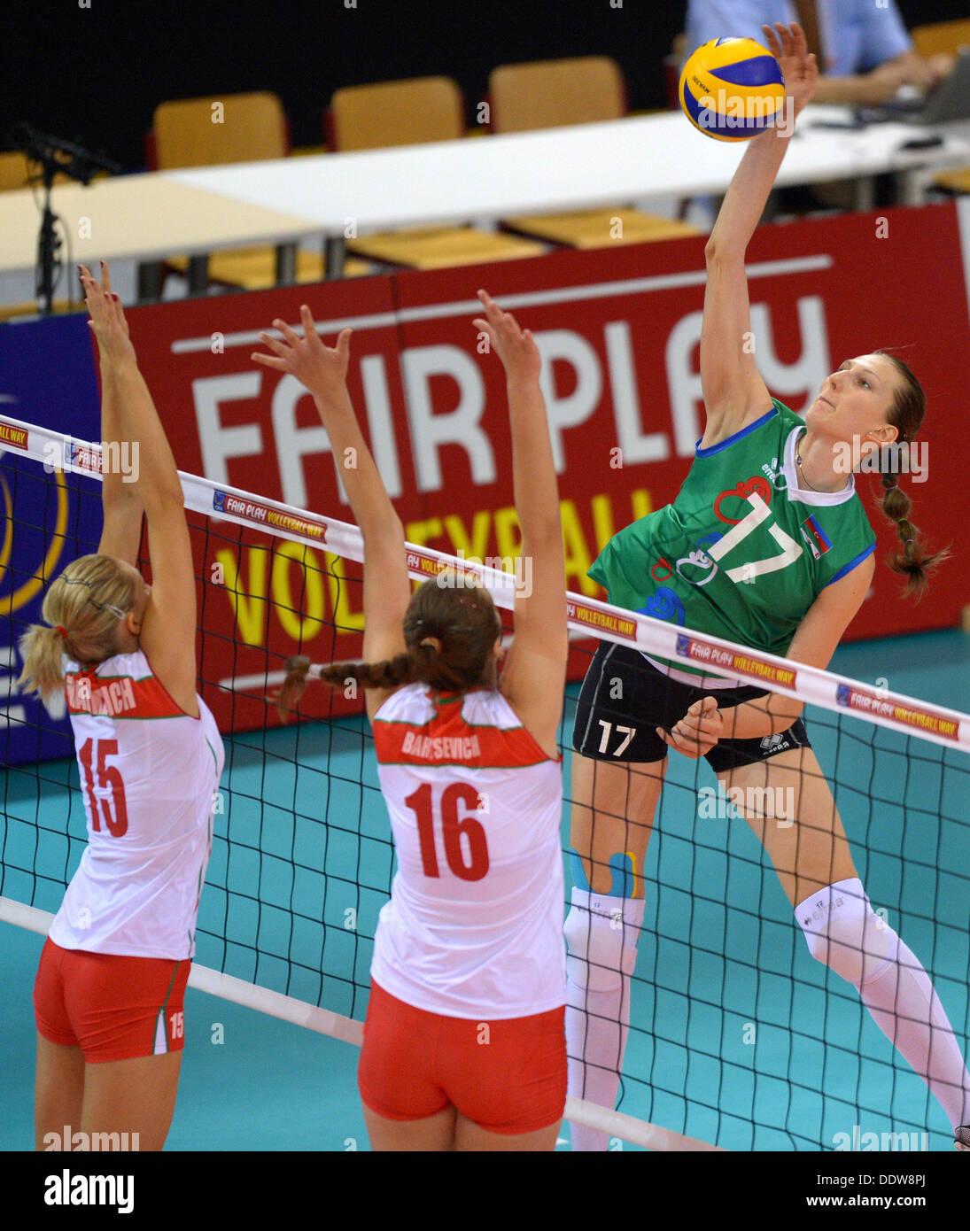 Tatsiana Markevich (L) and Anzhelika Barysevich (C) of Belarus in action against Polina Rahimova of Azerbaijan during Stock Photo