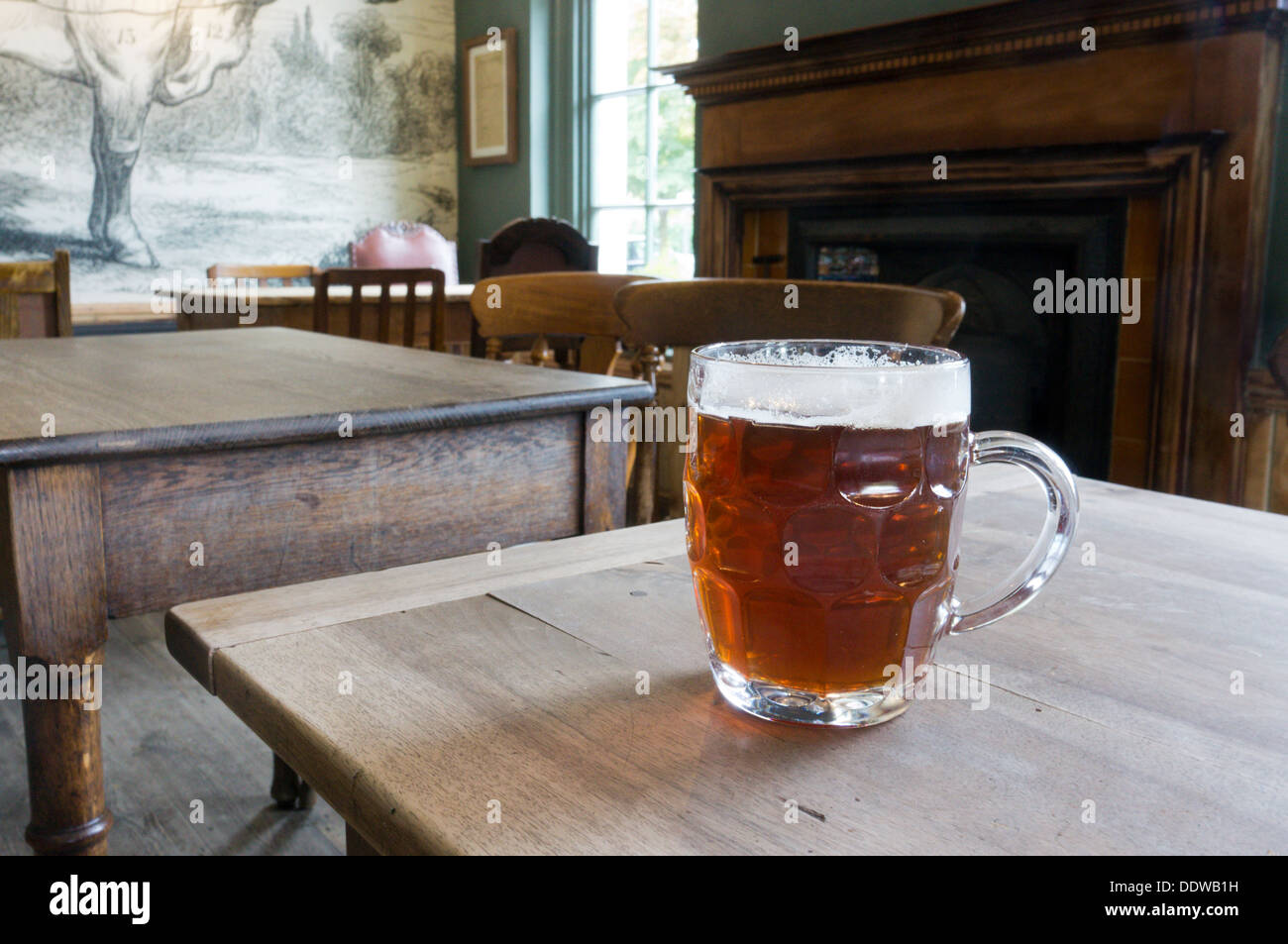 A pint mug of Hare Ale in the Hare and Billet pub at Blackheath, south London.. - Stock Image