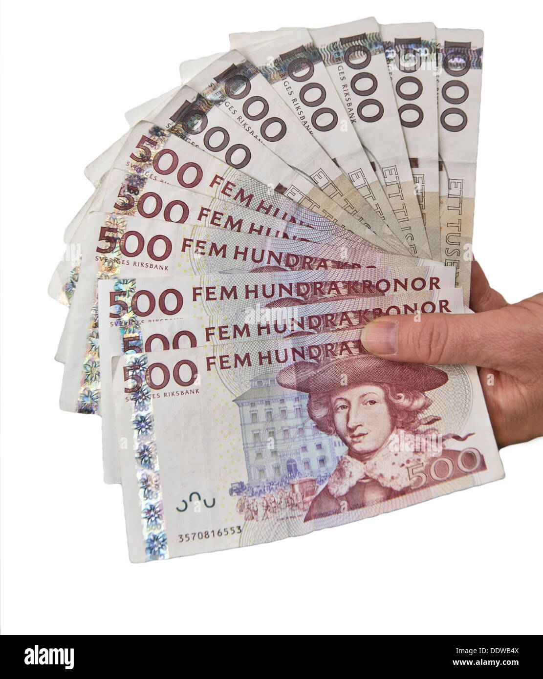 Handful of Swedish 500 and 1000 bills isolated on white background - Stock Image