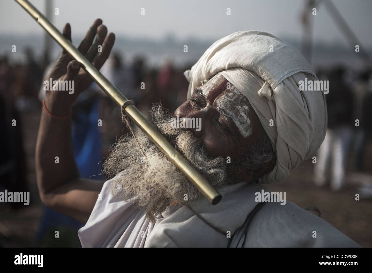 Naga Sadhu - The Great Renounce blowing flute and in his trance meditating at Kumbh Mela 2013, India - Stock Image