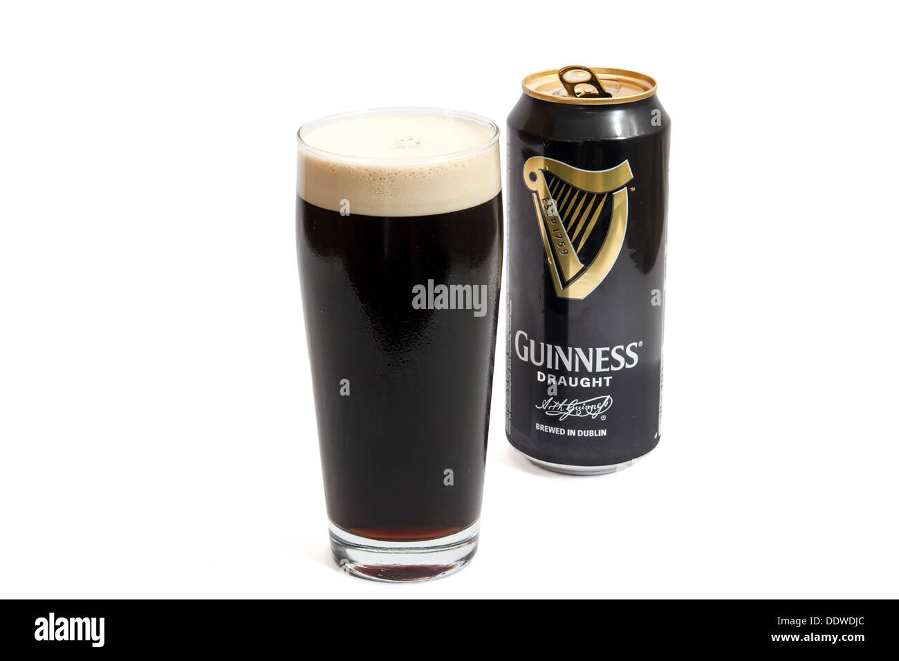 Pint of draught guinness and can - Stock Image