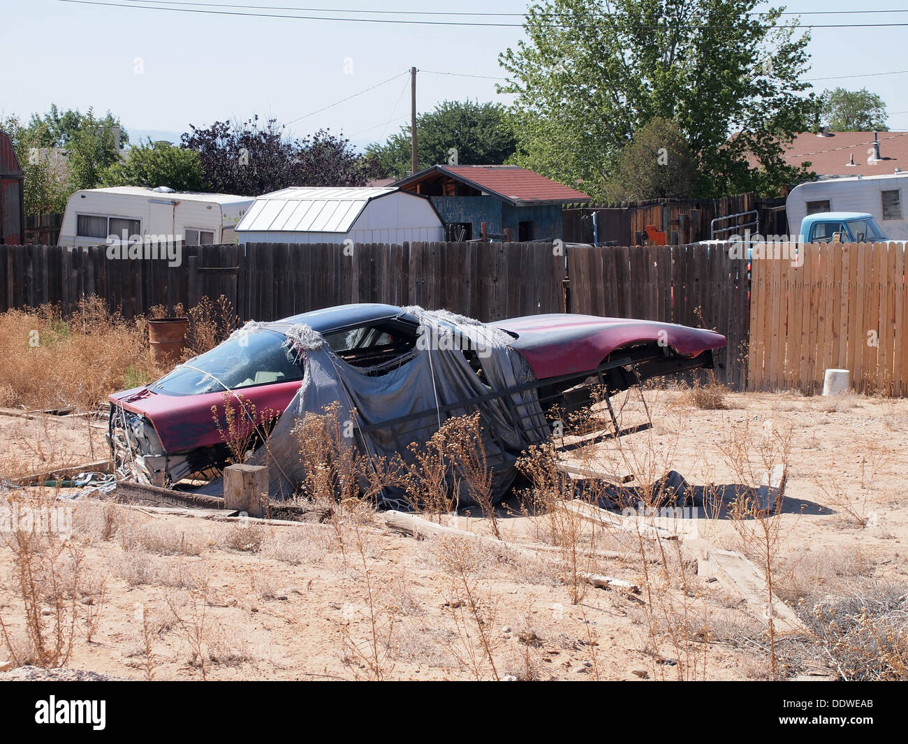 Junked car body in an empty lot in Rio Rancho, New Mexico, USA Stock ...